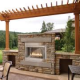 Outdoor fireplace with a pergola to enhance the beauty.