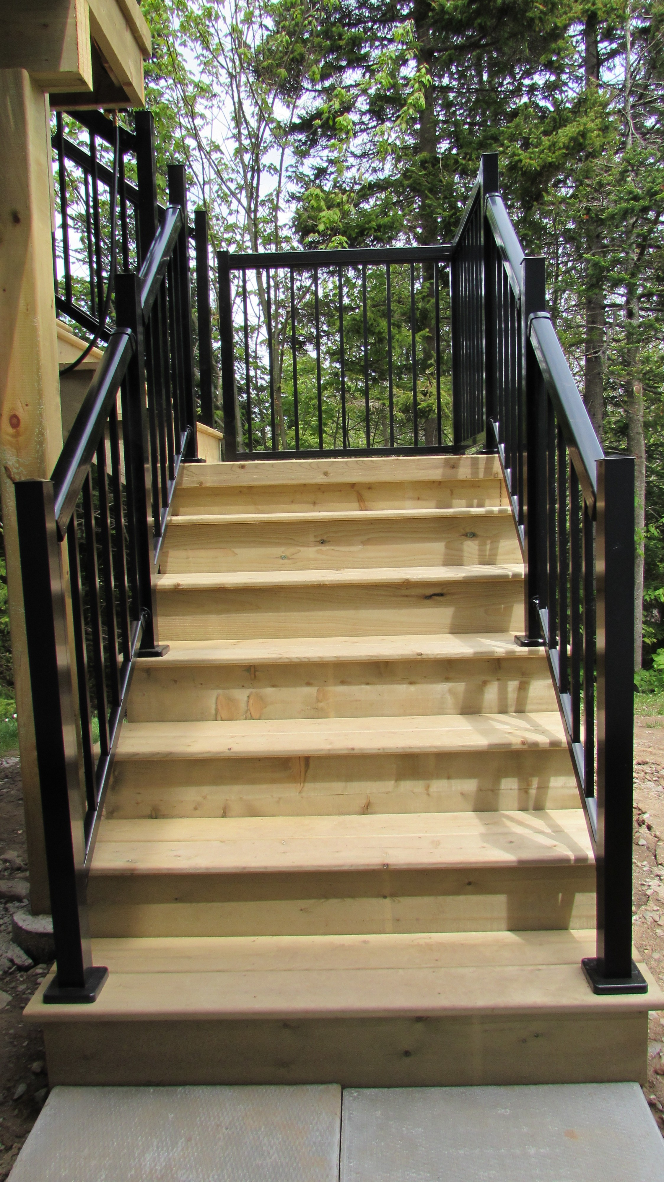 Pressure Treated Deck With A Regal Railing System