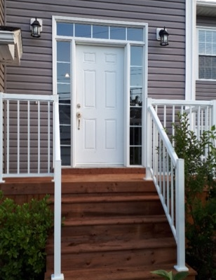 front entry with aluminum railing