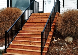 custom front steps with metal railings